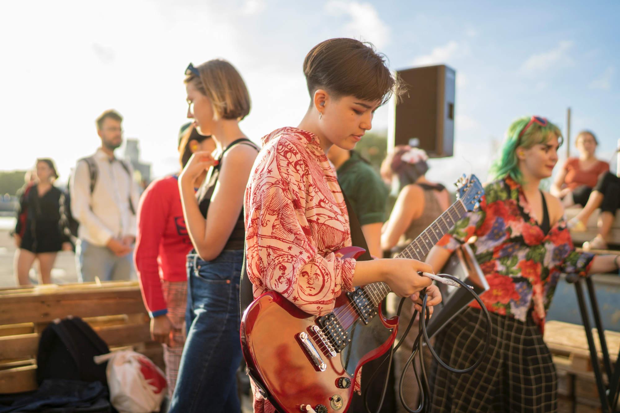 Bass player in plaid shirt